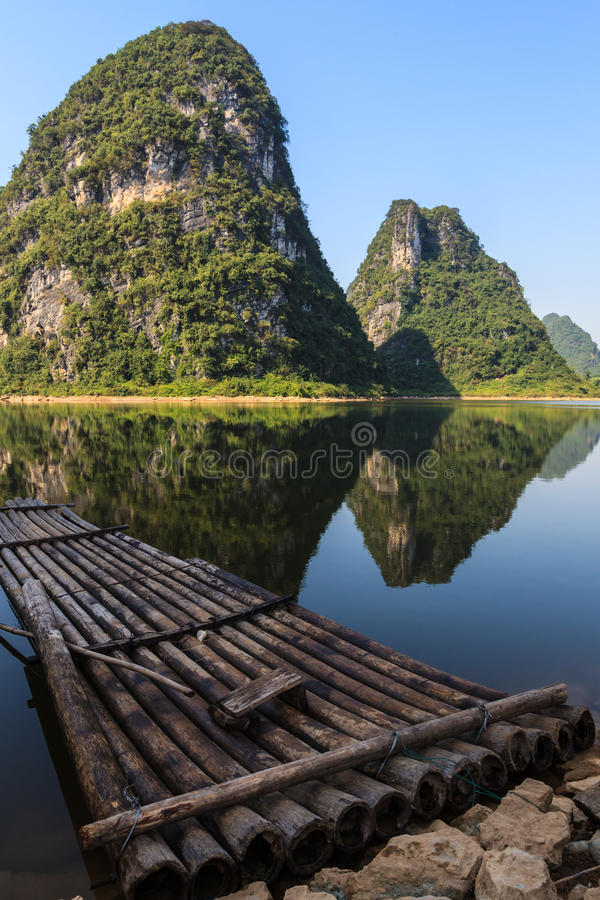 Bamboo raft at Li river with limestone hills royalty free stock image