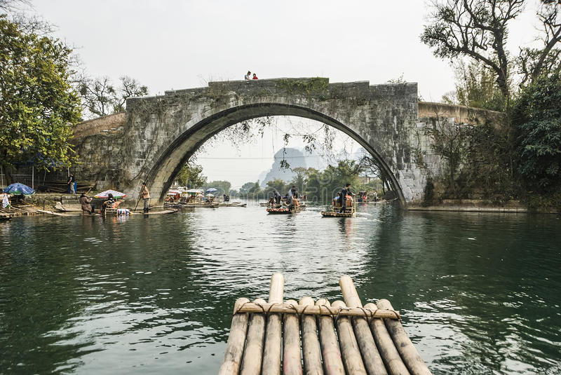Bamboo rafting along Yulong River during the winter season with beauty of the landscape is a popular activity in Guilin. Guilin, China - Jan 29, 2013: Tourists royalty free stock image