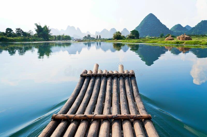 Bamboo raft on Li River, China. Bamboo raft in blue waters of Li River, Guangxi Zhuang Autonomous Region between Guilin and Yangshou, China with scenic karst stock photo