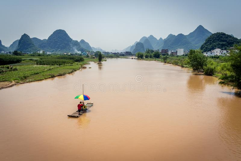 Bamboo Rafts on river and karst mountains royalty free stock photography