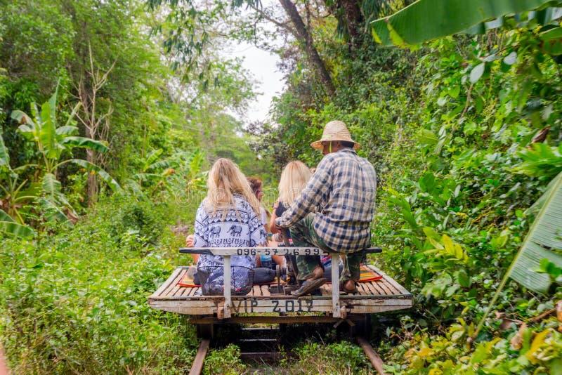 Bamboo railway, Battambang, Cambodia. BATTAMBANG, CAMBODIA - APRIL 1: Group of people riding old fashioned bamboo railway. April 2017 stock images