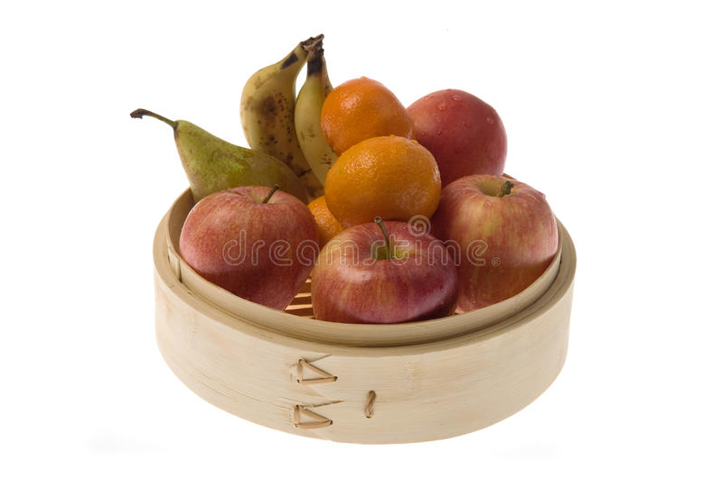 Bamboo recipient with fruits royalty free stock images