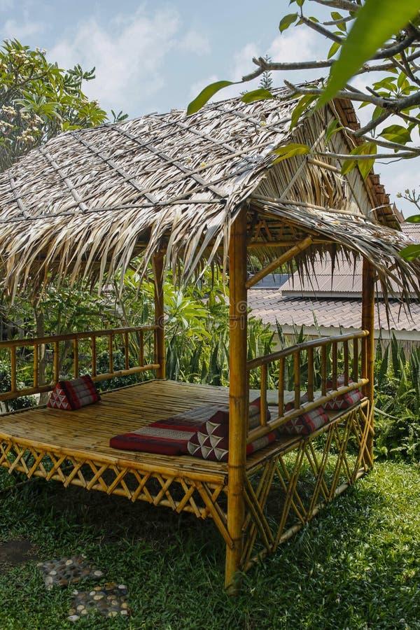 Bamboo hut in the garden. Bamboo relaxing hut in the garden stock photo