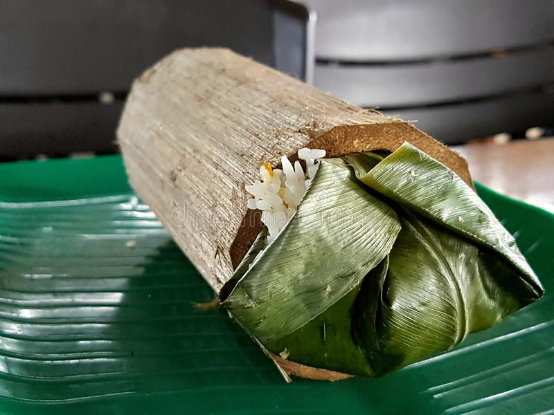 Bamboo Rice. White rice wrapped with green leaf and cooked in bamboo royalty free stock photos