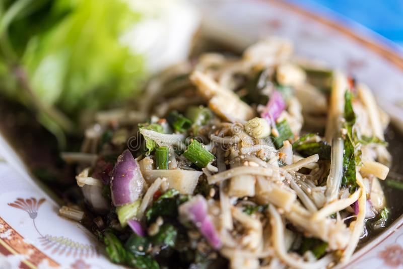 Bamboo shoot spicy salad Soup Knor Mai in market. Bamboo shoot spicy salad Soup Knor Mai is northeastern Thai food for sale at Thai street food market or royalty free stock image