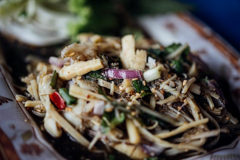 Bamboo shoot spicy salad Soup Knor Mai in market. Bamboo shoot spicy salad Soup Knor Mai is northeastern Thai food for sale at Thai street food market or royalty free stock images