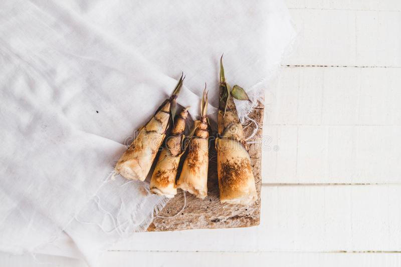 Bamboo shoot uncooked On the cloth and the white table royalty free stock photo