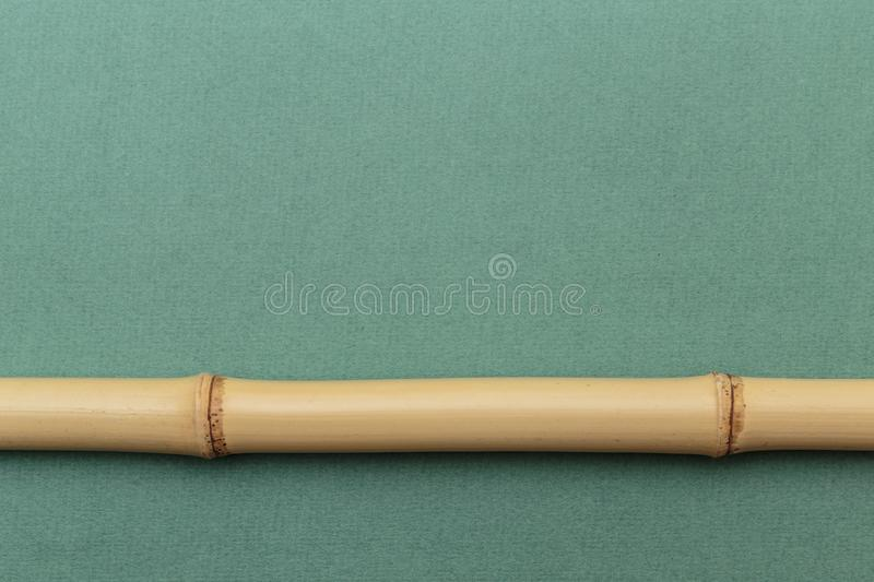 Bamboo stick. On a green background stock photography