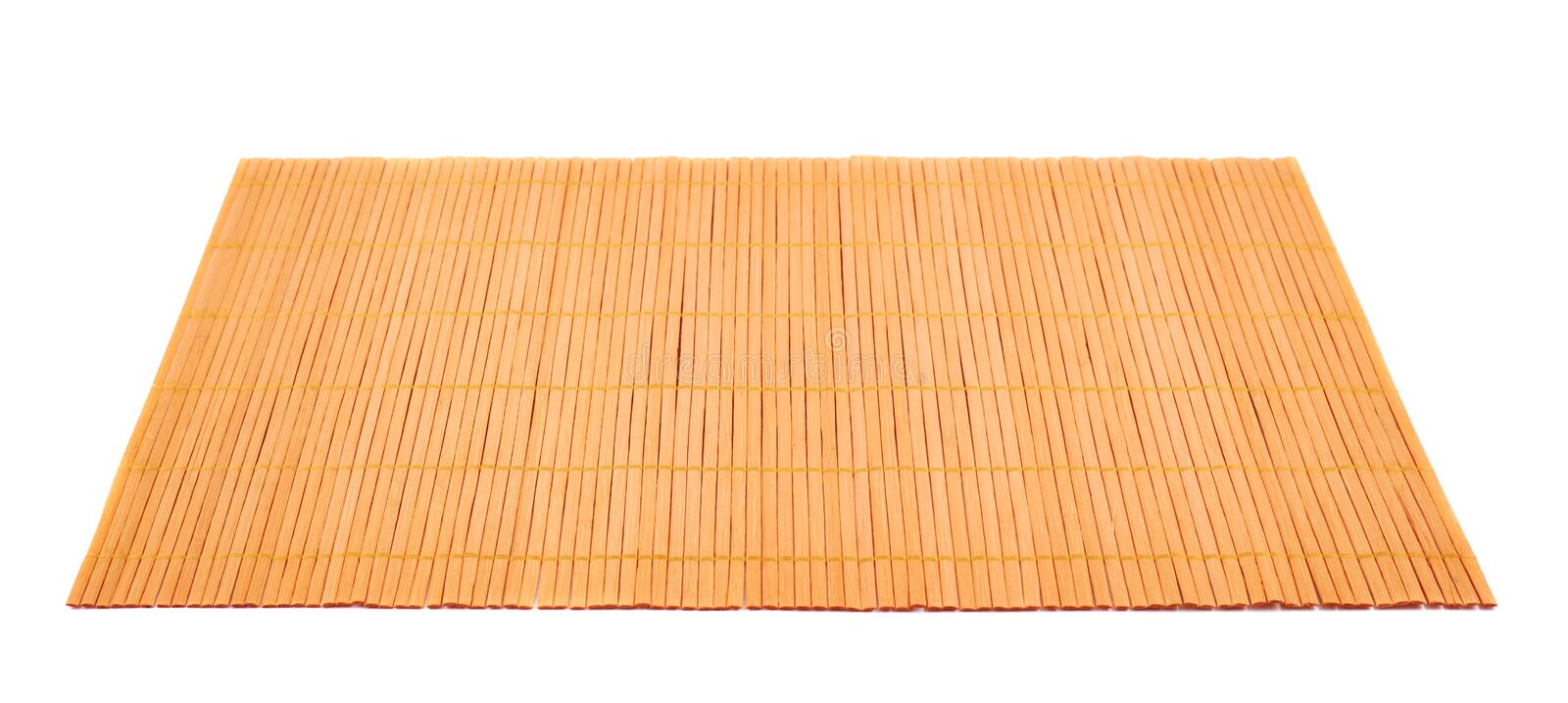 Bamboo straw serving mat isolated. Bamboo brown straw serving mat isolated over white background royalty free stock photo