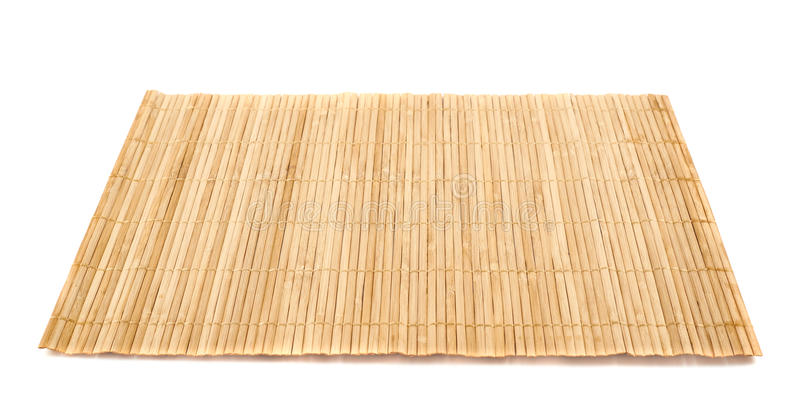 Bamboo straw serving mat isolated. Bamboo brown straw serving mat isolated over white background royalty free stock image