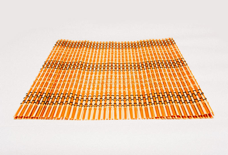 Bamboo straw serving mat. On white background stock photo