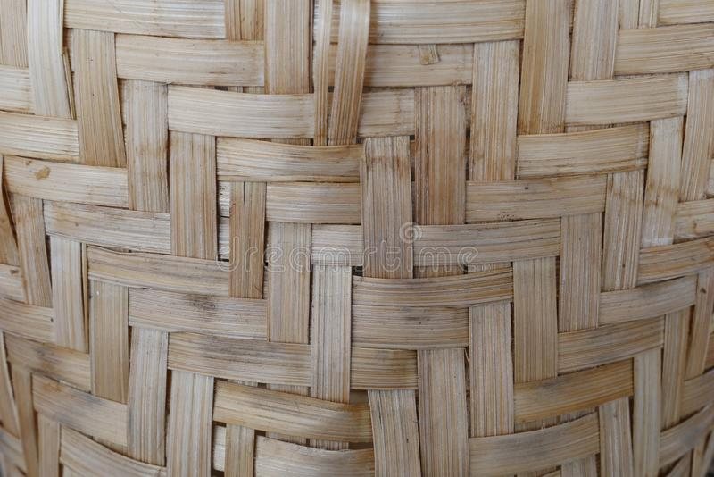 Bamboo or straw weaving. wooden Basket texture background. Bamboo or straw weaving texture as background,vintage Asian craft idea wood background stock photo