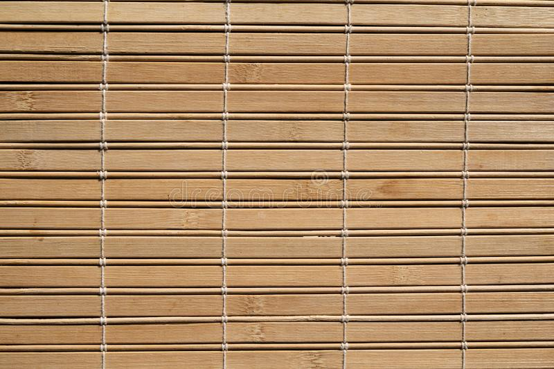 Bamboo style wood blinds pattern texture in good condition. High quality, brown bamboo wood surface pattern texture in good condition royalty free stock image