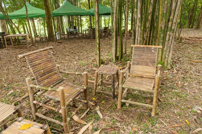 Bamboo table and chairs in garden. royalty free stock photos