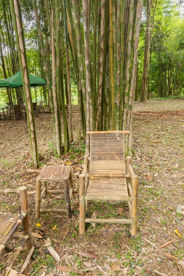 Bamboo table and chairs in garden. stock photo