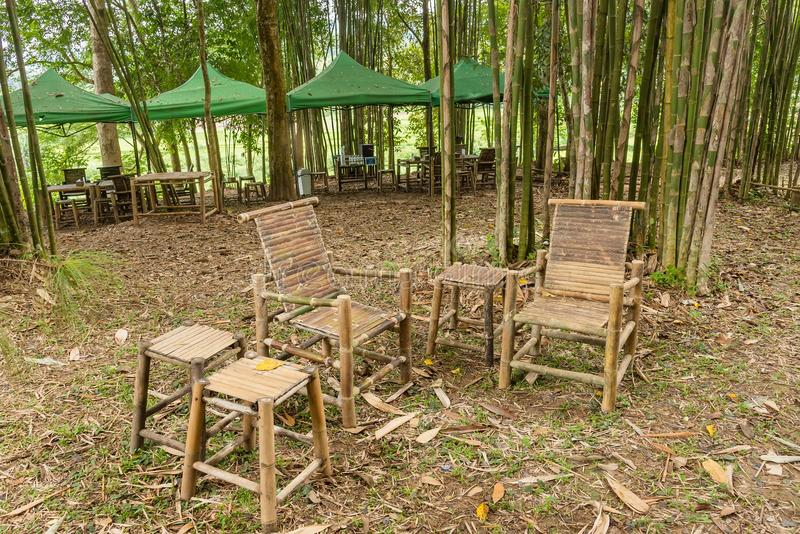Bamboo table and chairs in garden. stock photos