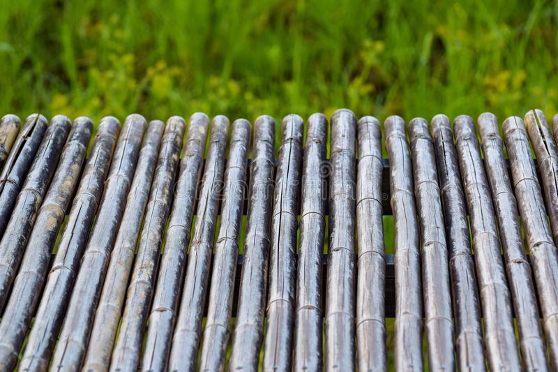 bamboo table for product display montages.bamboo texture pattern background, blurred green grass stock photos