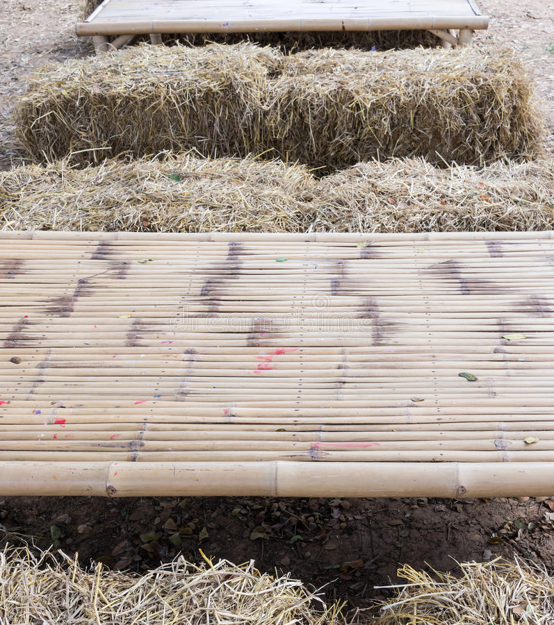 Bamboo table with straw briquette stock images