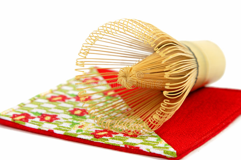 Bamboo tea whisk. On a piece of a specific Japanese crepe fabric-detail royalty free stock photography