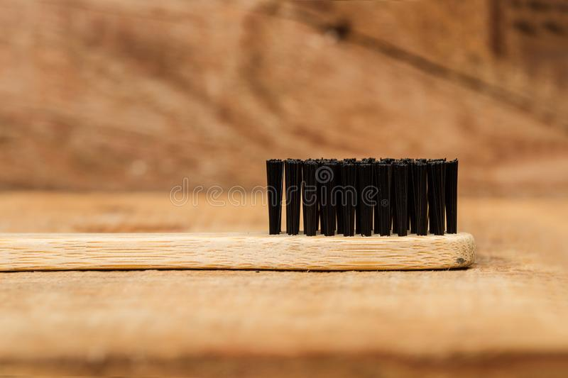 A Bamboo toothbrush with black brush bristles royalty free stock photo