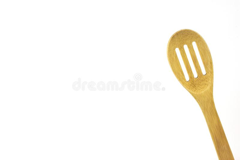 Wooden pasta spoon, isolated, high key. Wooden utensil, isolated,high key, room for text, for cooking ads, billboards royalty free stock photo