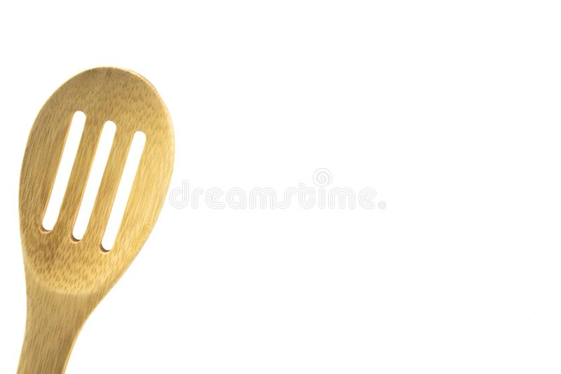 Bamboo, wood pasta spoon, isolated, high key. Wooden pasta spoon with room for text, high key, use for magazine ads, cooking stock images