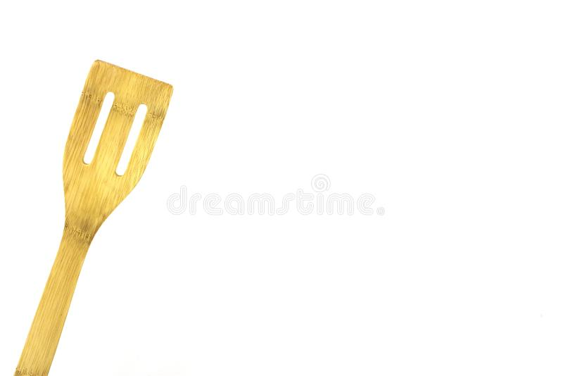 Bamboo spatula, isolated, high key. Wood spatula, bamboo spatula, high key photo, use for ads, room for text royalty free stock photography