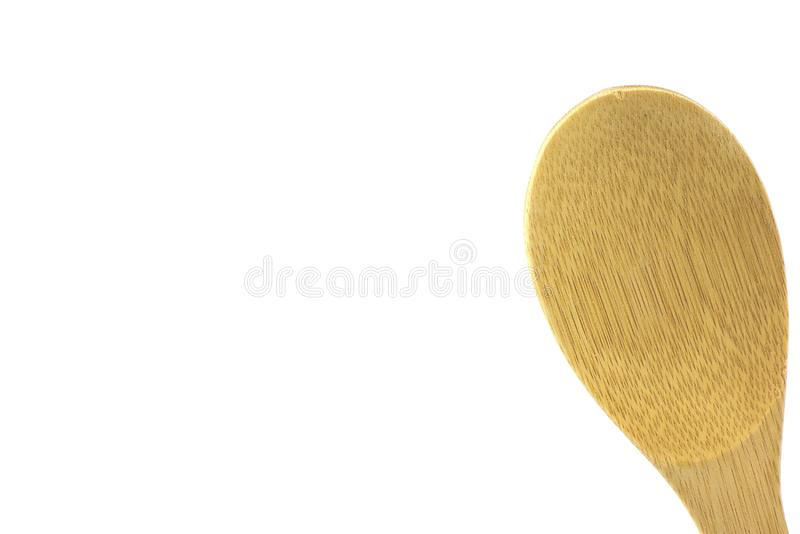 Large wooden spoon, isolated, high key. Wooden utensil, isolated,high key, room for text, great for cooking and food ads royalty free stock photography