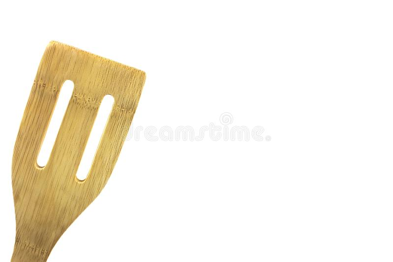Wooden spatula, isolated, high key. Wooden utensil, isolated,high key, room for text, for cooking and food ads royalty free stock image