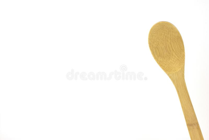 Wooden spoon, large, isolated, high key. Wooden utensil, isolated,high key, room for text, use for cooking and food ads royalty free stock photos