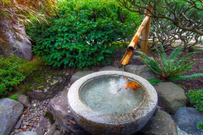 Bamboo Water Fountain in Japanese Garden. Stone Basin Bamboo Water Fountain in Portland Japanese Garden royalty free stock image