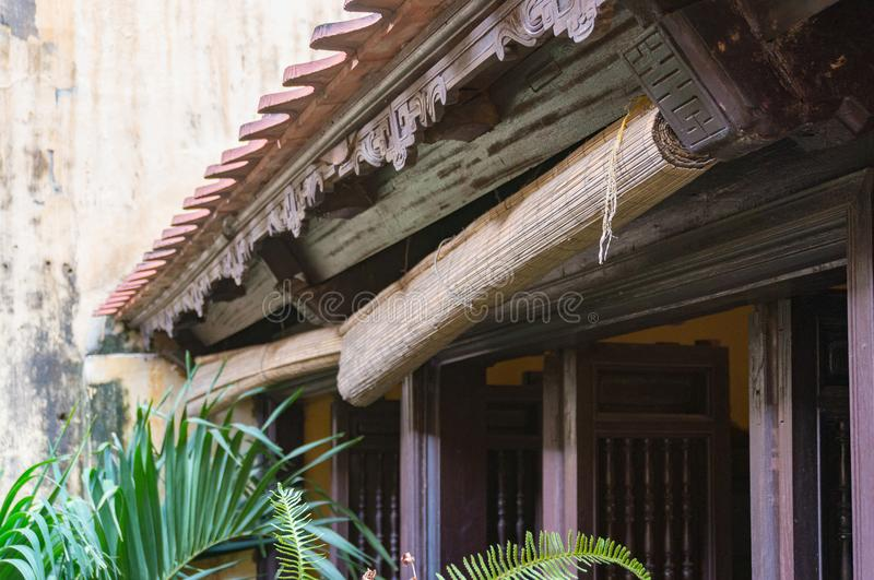 Rolled up bamboo window blinds. Traditional Vietnamese house detail royalty free stock photo
