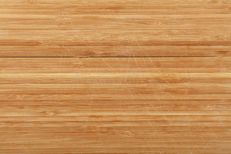 bamboo wood chopping board background with cuts stock