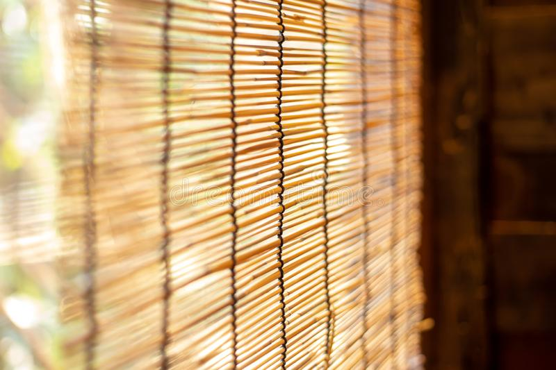 Bamboo wooden roll windows sun shade. Asian Chinese nature living home decoration style royalty free stock photography