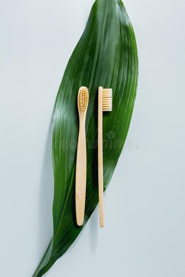Bamboo wooden toothbrushes on pastel stock photos