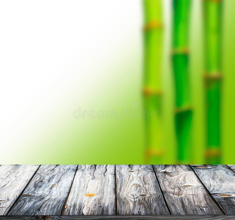 Bambubakgrund och trägolv arkivfoto