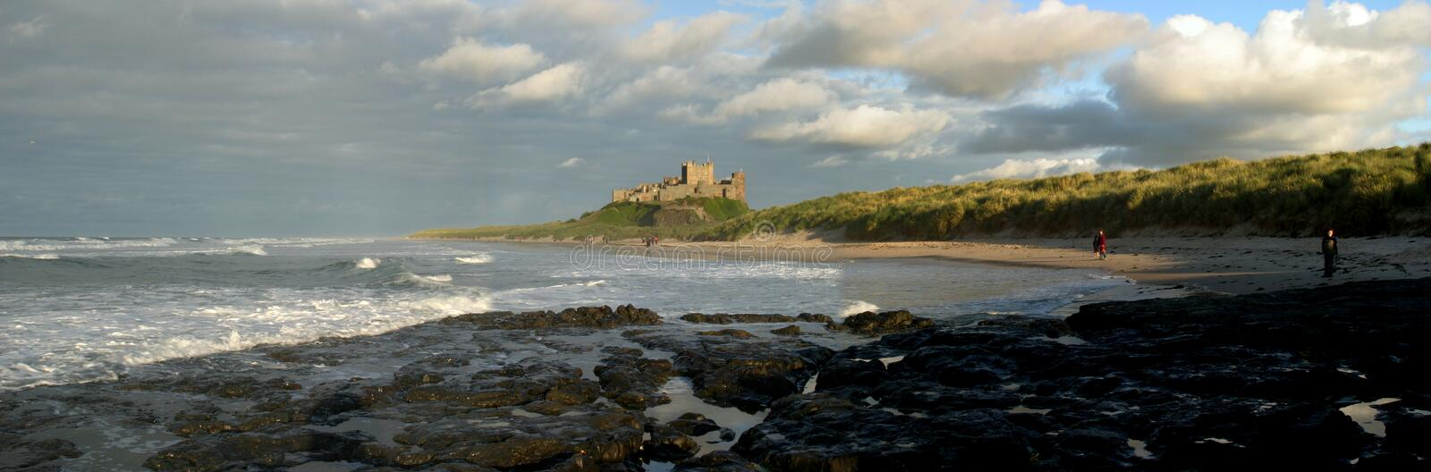 Bamburgh. Castle, reflecting a stormy sunset royalty free stock image