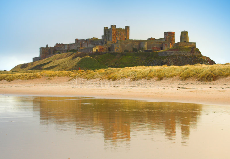 Bamburgh Castle. And reflection in the sea stock image