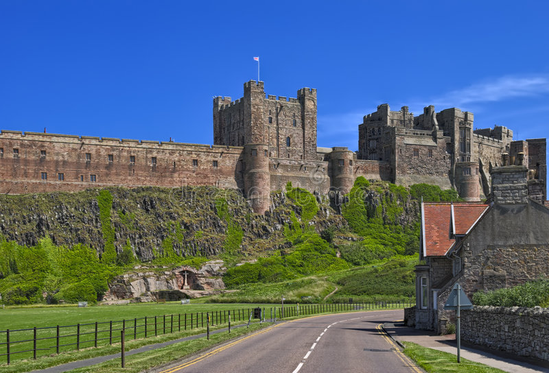 Bamburgh Castle. Dominates the village of the same name royalty free stock photography