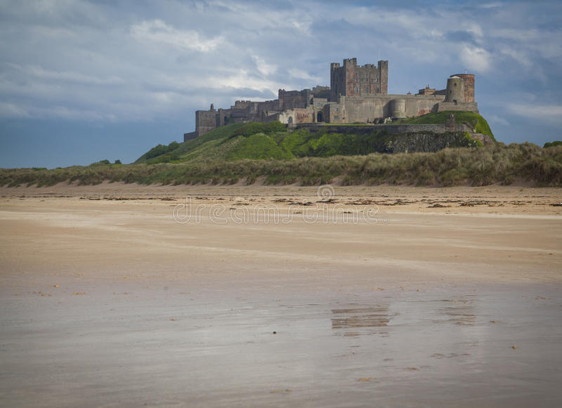 Bamburgh Castle. And beach in Northumberland royalty free stock photography