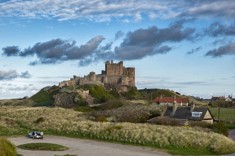 Bamburgh Castle. Bamburgh high street with the Castle in the background royalty free stock photo