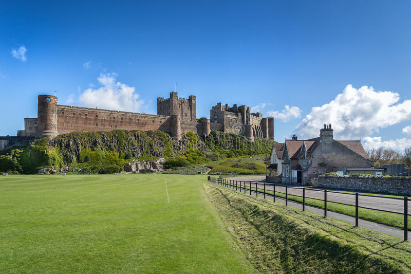 Bamburgh Castle. Bamburgh high street with the Castle in the background stock photos