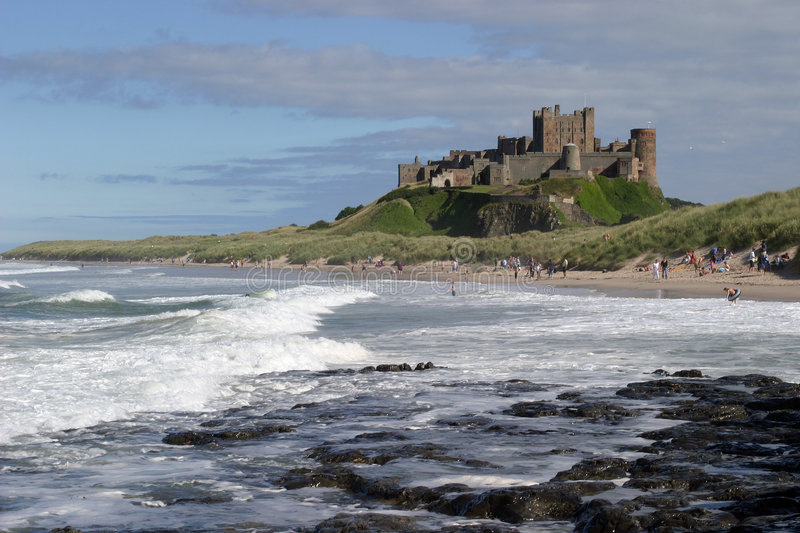 Bamburgh Castle II. Bamburgh Castle is probably the finest castle in England. It is perched on a basalt outcrop on the very edge of the North Sea at Bamburgh royalty free stock photo