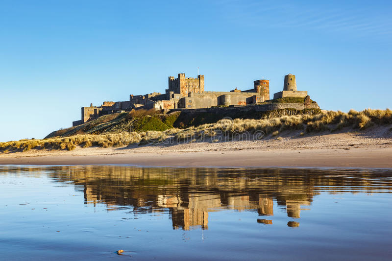 Bamburgh Castle Northumberland England. Reflection of a Bamburgh castle with clear blue skyline on Northumberland coast, England royalty free stock photography