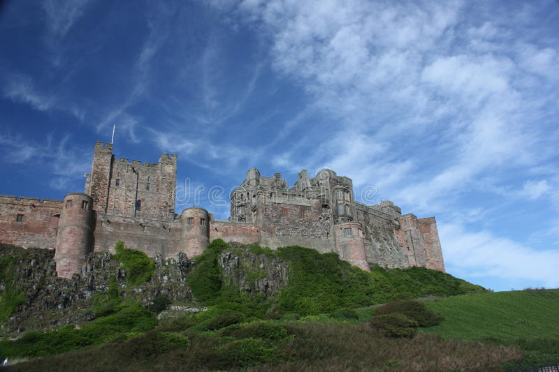 Bamburgh Castle shown on raised land royalty free stock photos