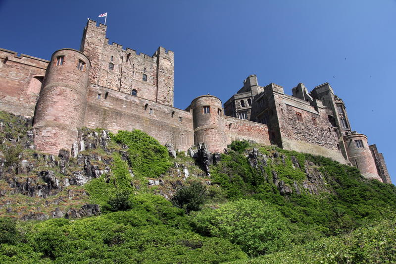 Bamburgh Castle. Sprawling dramatically across nine acres of land, high on it`s rocky perch above the Northumberland coastline, Bamburgh is one of the largest royalty free stock images