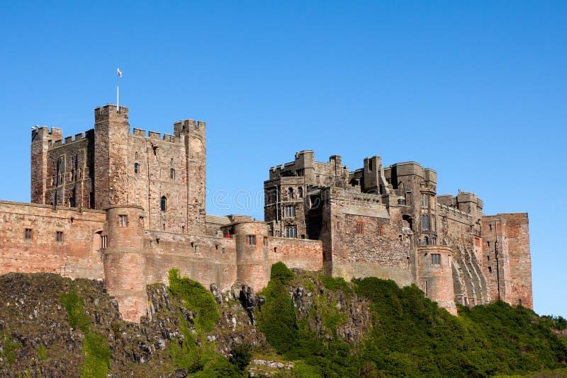 BAMBURGH, NORTHUMBERLAND/UK - 15-ОЕ АВГУСТА: Замок Bamburgh в Bam стоковое фото rf