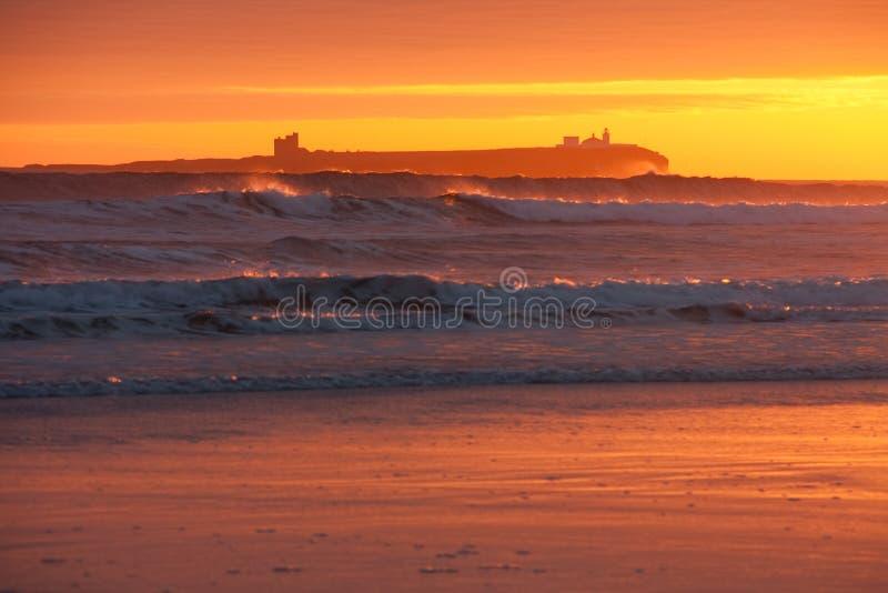 bamburgh wschód słońca zdjęcie royalty free