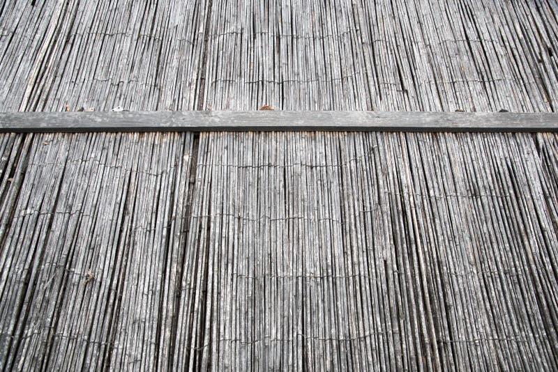Bambusstroh Detail des alten hölzernen Fensters stockbild
