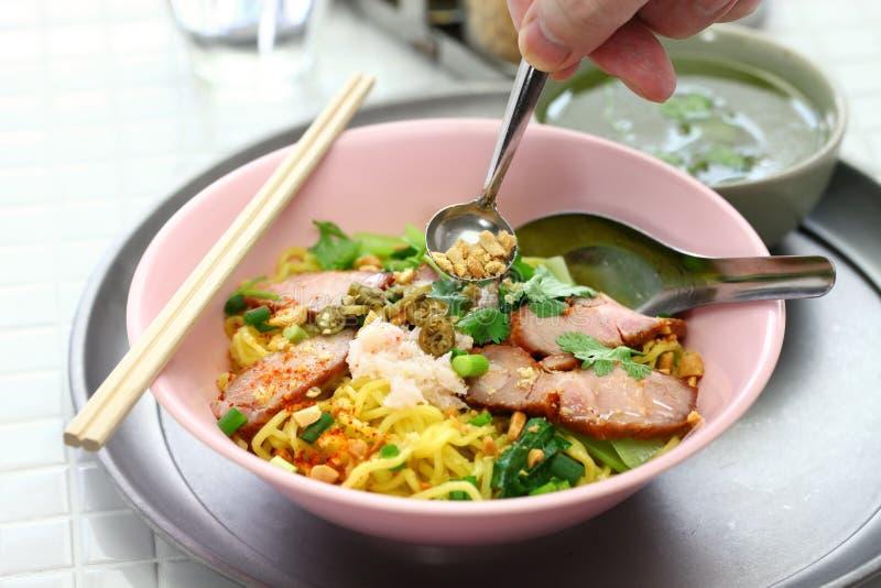 Egg noodles served with roast pork, thai food royalty free stock image